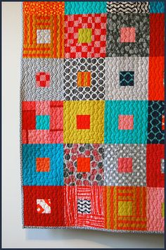 such a pretty bright scrappy baby quilt