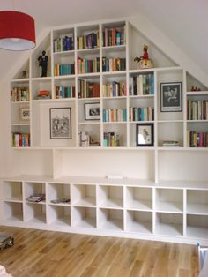 """Something like this for the window wall only not quite so uniform. There has to be a """"shelf"""" for the TV to fit in. Problems: She has requested the shelf NOT come over her bed. The bed comes in front of the window about 6 inches. Concerns: The top shelf may """"end strange""""."""