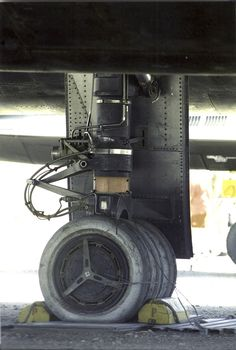 Note the bare titanium inside the landing gear door, and the aluminum added to the tire rubber to reflect heat away from the rubber in cruising flight. The SR-71 was made of titanium because it couldn't have flown as fast if made from aluminum- heating from just the speed through the air would have weakened aluminum too much. As to the 3 wheel/3 tire design- more surface area for the tires, lower loading, softer landing. This plane has moved since I took the picture- I can't see it on the…
