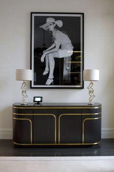 Black cabinet with golden details. Discover more: www.buffetsandcabinets.com | #blackcabinet #livingroomcabinet #cabinetdesign