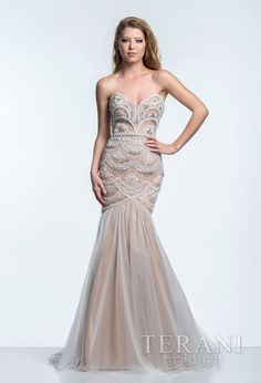 Strapless evening gown with a sweetheart neckline and scalloped stone motif covering the body of the dress and ending at the delicately embellished tulle trumpet skirt.