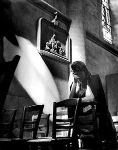 July 1944: A French woman prays for lost loved ones in a church following the Battle of Cherbourg, Lower Normandy, France. The Battle of Cherbourg was part of the larger Battle of Normandy and was fought immediately after the successful Allied landings.