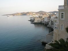District Vaporia - perhaps the most beautiful of Syros. Located north of the harbor, in the eastern part of Ermoupolis,  built next to the sea with wonderful houses, hanging over the rocks. #Greece #Syros #Terrabook #GreekIslands #Travel #Aegean #GreeceTravel #GreecePhotografy #GreekPhotos #AegeanSea #Traveling #Travelling #Holiday #Summer