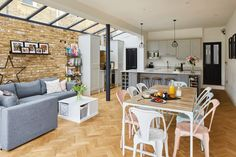 Side return extension with a glazed ceiling and exposed brick wall. Open Plan Kitchen Dining Living, Open Plan Kitchen Diner, Open Plan Living, Living Room Kitchen, Kitchen Extension Side Return, Kitchen Diner Extension, Victorian Terrace House, Victorian Kitchen, House Extension Design