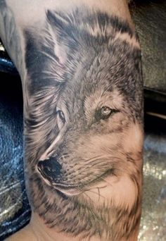 One of the best tattoo ideas for men, the extremely detailed wolf's head is made entirely in black ink. Description from menstattooideas.net. I searched for this on bing.com/images