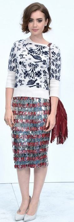 White print sweater, red fringe handbag, and silver sequin skirt