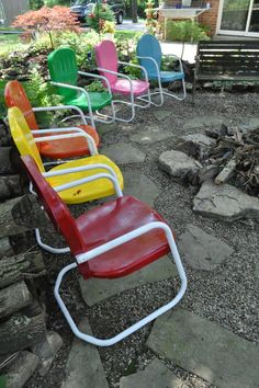 Trash Pickin' Tresures...sanded them and repainted and now we have a rainbow of chairs at the firepit