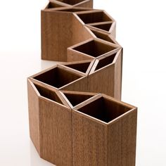 """<p><p>Beautifully crafted by artisans from Tokushima, these wooden stationary boxes magnetically connect. Designed in shapes of 30-degree increments – an equilateral triangle, a square and rhombus – the boxes freely come together to create geometric forms that act as pen stands, trays, or anything you need them to be.<br />  <a title=""""http://colors-cc.net/collections/magcontainer#.UkEvHWQkhi4"""" href=""""http://colors-cc.net/collections/magcontainer#.UkEvHWQkhi4""""…"""
