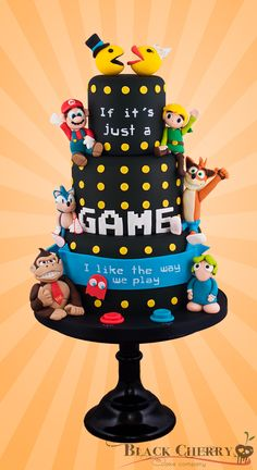 Geeky Classic Gamer Wedding Cake by Black Cherry Cake Company  Pac-Man, Mario, Zelda, Donkey Kong, Sonic, Crash, etc. This cake is heaven for the geek in me! ~Lulladies