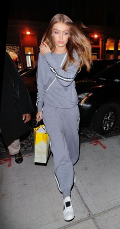 In a grey Olivia von Halle cashmere tracksuit, white crossbody and white M.Gemi sneakers while out in New York.