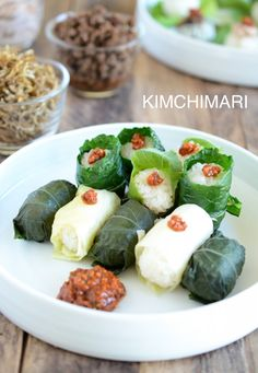 Ssam bap Korean lettuce wrap - wrapped in perilla, kale and cabbage leaves