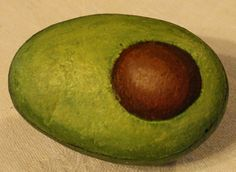 Avocado painted rock