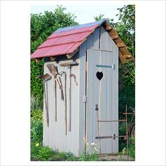 tiny cute shed. could put a half-moon on the door and pretend it's an outhouse!