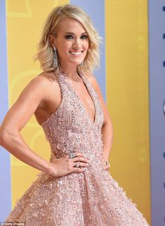 The country music star, 33, paired the gorgeous dress with enormous drop diamond earrings ...