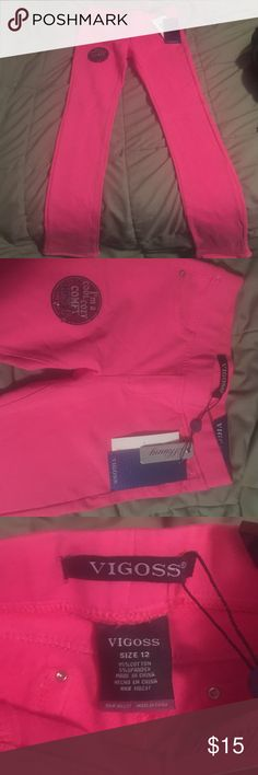 Pink jeggings size 12 Brand new with tags - SPARKLE accents on pockets. From smoke free home.  vigoss Bottoms Jeans
