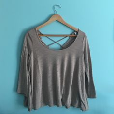 American Eagle Top Really cute taupe colored courter length sleeve top with an open back detail. In great condition and only worn a few times. (looks gray in the picture but it is actually a light tan / taupe color)                                                                     ❉I DO NOT TRADE ❉Please feel free to make an offer ❉I do bundle discounts ❉Fast Shipping! American Eagle Outfitters Tops Blouses