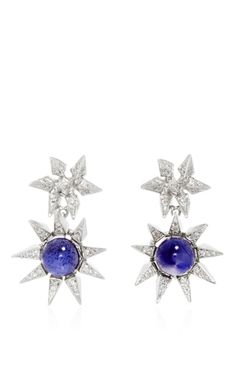 Based between Brooklyn and Beirut, jewelry designer Karma El Khalil favors a subtle elegance and plays with hidden details in her delicate, sharp pieces. These **Karma El Khalil** earrings combine 18K white gold, diamonds, and iolite for elegant earrings with an edge.
