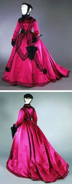 Dress, possibly American, ca. 1866-68. Four pieces: 2 bodices, skirt, and belt. Magenta silk satin with black silk satin & black cotton lace. Trimmed in the fashionable apron style, skirt has 9 tapered pieces at front & sides and one straight length at back, with deep pleating at back waist that flows into full train. Shown here is the high-necked bodice for formal daytime wear. It also has lower-cut evening bodice. Philadelphia Museum of Art