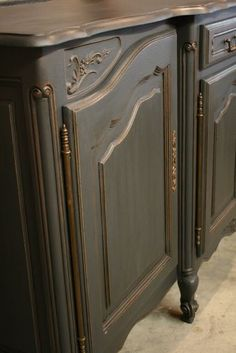 Annie Sloan Chalk Paint -- Graphite with distressing and dark wax thinned with mineral spirits to make a glaze. Brass hardware.