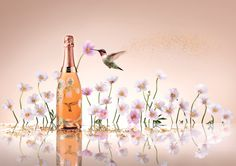 Originally created from scraps of gold, the enchanting scene was photographed and applied by Vik Muniz to the Belle Epoque bottle via a gold plate on which the hummingbird seemingly flies towards the foreground anemones. Clear glass allows the wine's salmon shade to offset Muniz's delicately sensual depiction.  #perrierjouet #VikMuniz #belleepoque #limitededition #champagne - Please Drink Responsibly