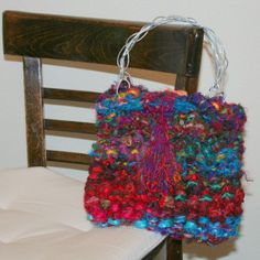 "This pattern uses unique ""yarn"" in a simple purse."