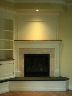 Corner Fireplace Ideas great idea to replace the retro fireplace in our living room