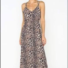 Leopard Print Maxi Brand new. This leopard print dress is classy and sassy all at the same time. And would you check out the strap details on the back?! ;) Dresses