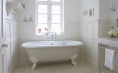 Updating your bathroom design doesn't have to cost an arm and a leg! Here are 7 tips to remodel your bathroom on a low budget. Budget Bathroom Remodel, Bathroom Renovations, Bad Inspiration, Bathroom Inspiration, Clean Shower Doors, Bathroom Paneling, Tiled Bathrooms, Wainscoting, Roll Top Bath