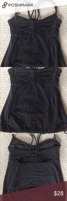 Lululemon black tank top 4 Yoga workout top with shirted bodice and back cutout, drawstring at bottom. lululemon athletica Tops Tank Tops