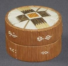 Round porcupine quill box in brown and white. First Nations; Mi'kmaq, (1875-1900)  dyed and natural porcupine quill, birchbark, spruce root and wood.11 cm x 8 cm x 8 cm Brunswick Museum - Search Art, History & Photography