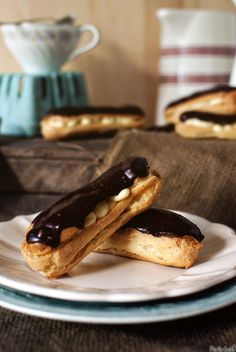 Classic eclaires with vanilla filling and chocolate frosting.