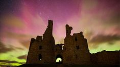 There have been spectacular displays of the Aurora Borealis - better known as the Northern Lights - across parts of the UK overnight. The colourful phenomenon was visible in Scotland and Northern Ireland, but was also spotted as far south as Anglesey and Oxfordshire. Aurora Borealis occurs when electrically-charged particles from the Sun enter the Earth's atmosphere. Dunstanburgh Castle in Northumberland made a dramatic setting for the pink shades of Aurora Borealis