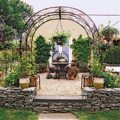 If the view from your backyard faces an ugly shed or garage, think about incorporating it into your garden design.