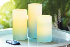 Light Illusions LED Pillar candles. Available in Blue Ombre (pictured) and Ivory.  https://www.facebook.com/invigorateyoursenseswithTrisha/