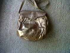 Borbonese extremely soft gold leather and embroidery for this early 70s small shoulder bag. (wrinkles are due to softness)