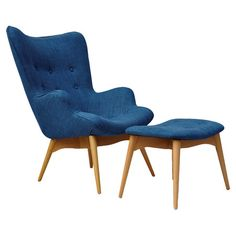 A stylish addition to your living room seating group or master suite ensemble, this ash wood arm chair and ottoman showcases blue linen upholstery and button...