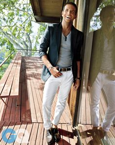 T-shirt,jeans, blazer, and beltbyTom Ford. Watch byZenith. Loafers byLouis Vuitton.