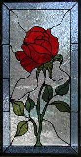 Red Rose Stained Glass. I think it would be beautiful to have a huge stained glass rose on the wall in a library/garden. The Library would open up to an outside area with a little sitting area and fountain in the garden. #StainedGlassBeautyAndTheBeast