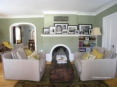 Black and white photo grouping on fireplace mantel all in black frames with family saying above in living room when you walk into foyer antique chest for a coffee table http://www.tourfactory.com/847549