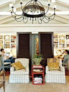 A pair of his-and-hers offices located in the heart of this home can be easily concealed by sliding shutter doors when company comes. | myhomeideas.com