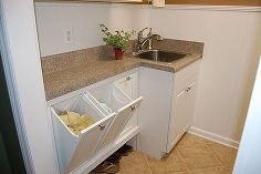 laundry room re do, doors, home decor, home improvement, laundry rooms, I took a 3 unit hamper from Decorators Collection and repurposed it here We took a stock countertop and cut part of it away to fit the hampers We store shoes underneath