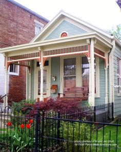 Shotgun house with neat exterior trim in Madison Indiana. Great place to visit. From Front Porch Ideas and More #porch #madisonindiana