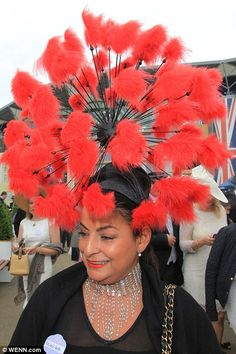 A woman in a red hat, Royal Ascot, June 17, 2016.