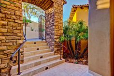 The entrance to this Ahwatukee Exquisite Old World Estate in Gated Tapestry is asking $1.75 Million