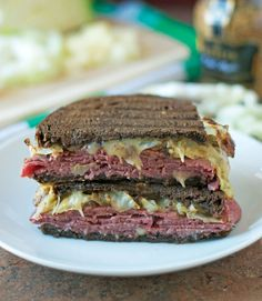 The ultimate St. Salty corned beef, sauteed cabbage, and gooey Irish cheddar on pumpernickel bread create a savory, satisfying sandwich that's perfect for St. Patrick's Day or any quick weeknight dinner. Sauteed Cabbage, Corn Beef And Cabbage, Cabbage Recipes, Beef Recipes, Cooking Recipes, Healthy Recipes, Zoodle Recipes, Easy Recipes, Snack Recipes