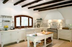 Bright, white farmhouse style kitchen in a Spanish villa. #homeandstyleliving