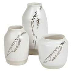 Pretty little ceramic vases with platinum colored details.