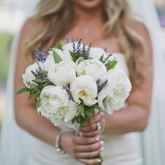 A bouquet of white peonies and lavender | Photo by Happy Confetti Photography