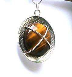 Round Tiger Eye Pendant Konstantis Jewelry http://www.amazon.com/dp/B00QYRWGO6/ref=cm_sw_r_pi_dp_iSiKub0J7J0QF