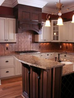 Kitchen, some white washed cabinets and dark cabinets with tin backsplash! I am in love :)